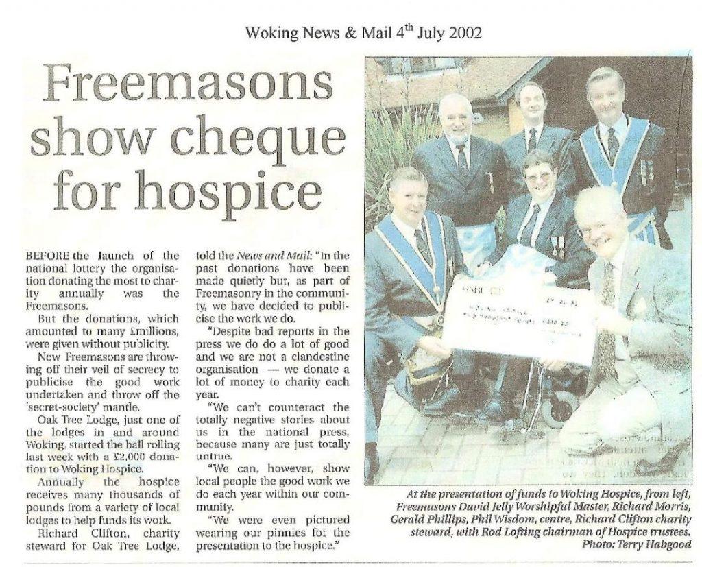 Members of Oak Tree Lodge donate £2000 to Woking hospice